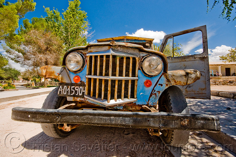 front of an old jeep (argentina), 4x4, a015904, all-terrain, argentina, bald tire, car grill, classic car, front bumper, grill guard, headlights, lorry, molinos, noroeste argentino, old, pickup truck, rusty, willy's jeep
