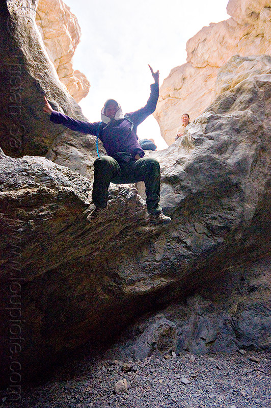 fun times in grotto canyon, dana, death valley, desert, grotto canyon, jump, jumper, jumping down, jumpshot, mountain, peace sign, rock, slot canyon, stone, v sign, woman