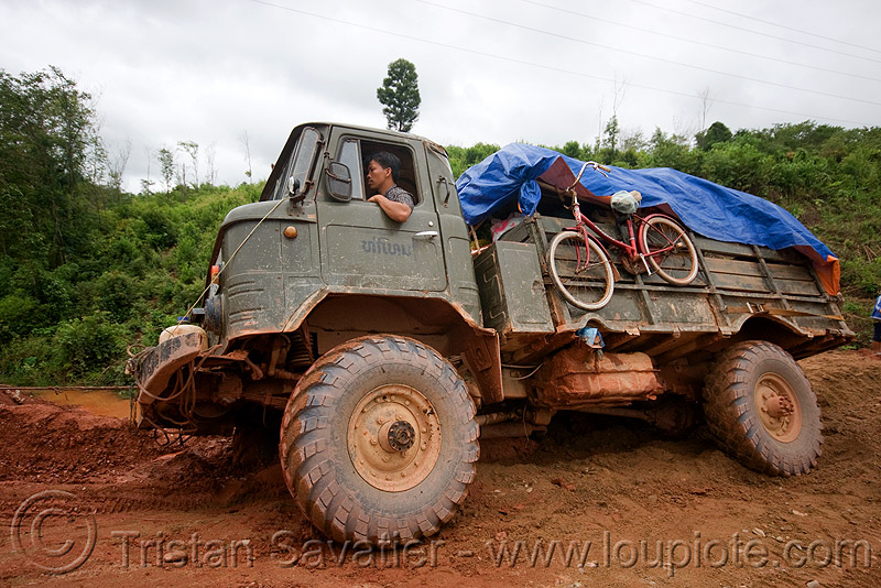 GAZ-66 - ГАЗ-66 - russian all terrain 4x4 truck stuck in mud (laos), army truck, gorkovsky avtomobilny zavod, lorry, military truck, people, road, truck mud tires, газ, газ-66, го́рьковский автомоби́льный заво́д