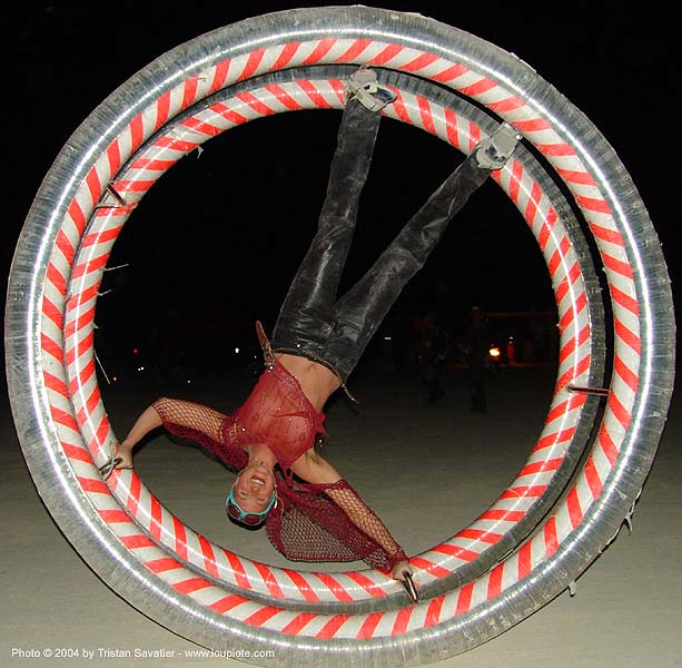 german wheel at burning man 2004, burning man, german wheel, night, rolling, upside-down, woman