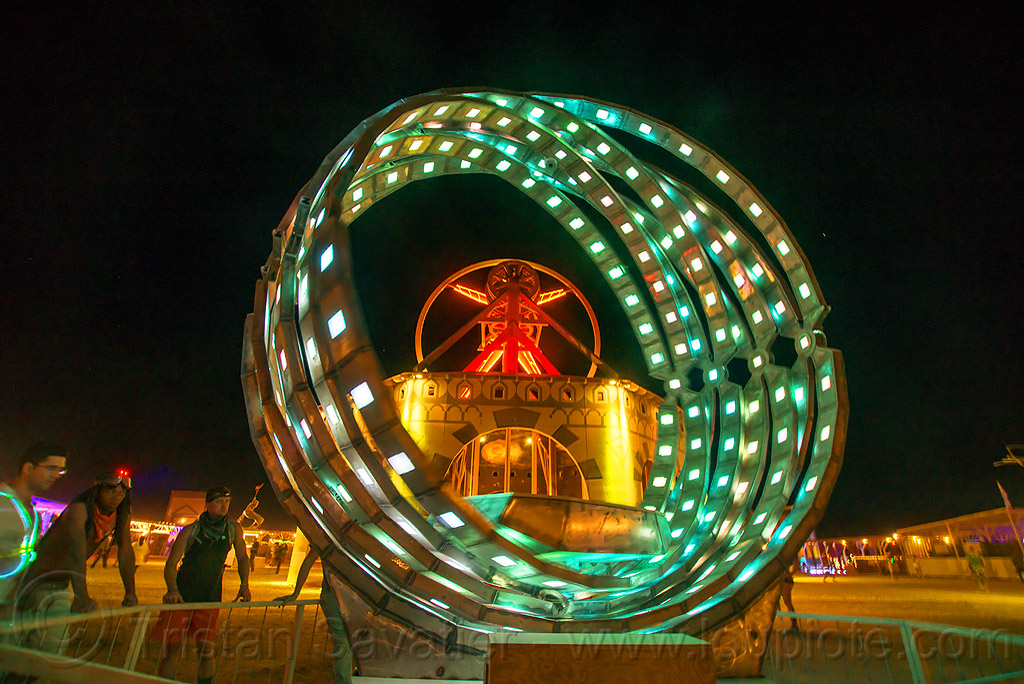 giant animated steel rings sculpture with LED lights - burning man 2016, animated, art installation, burning man, disc-go-sphere, glowing, led light, metal, night, rings, sculpture, the man