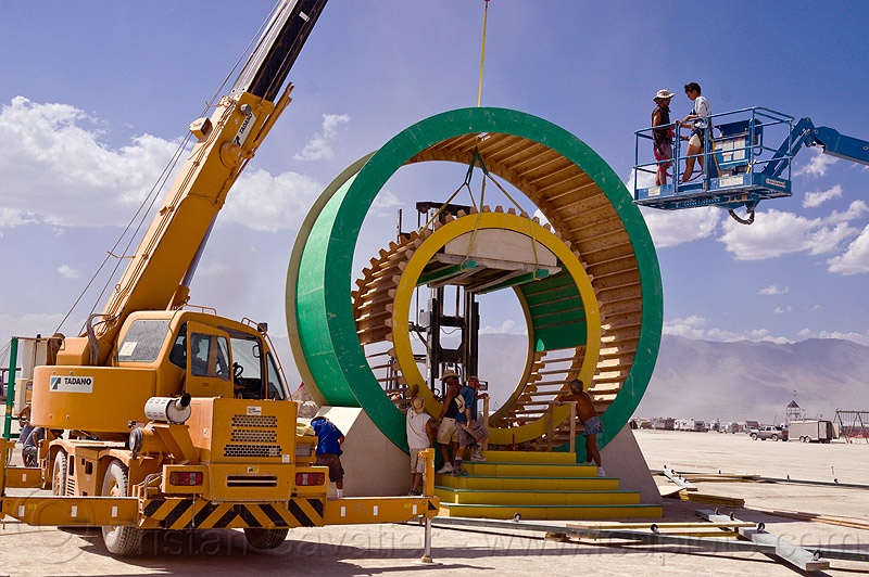 giant hamster wheel - burning man 2012, burning man, geared, machinery, mayan tricycle, mayan trike, wheels, wood gears, wooden gears