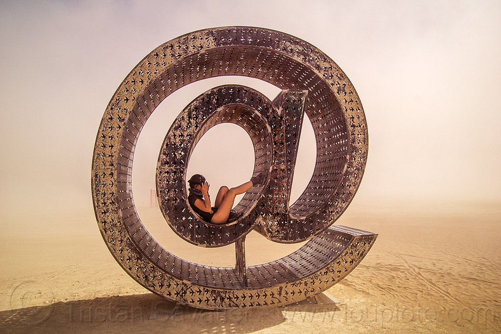 @ - giant letter sculpture - burning man 2016, @earth #home, art installation, big words, burning man, metal sculpture, steel, woman