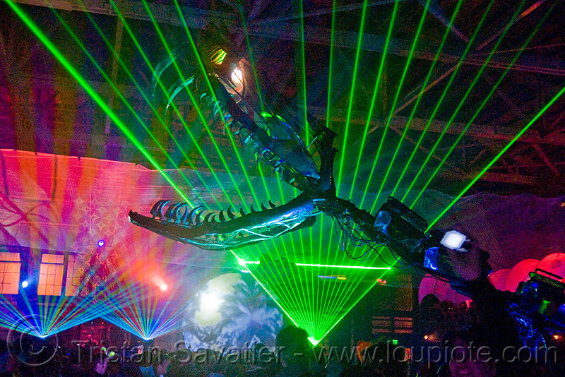 giant snake skeleton animated sculpture - opulent temple massive rave party (treasure island, san francisco) - serpent mother, art installation, fangs, flaming lotus girls, green laser, head, laser lightshow, laser show, lasers, night, nightclub, teeth