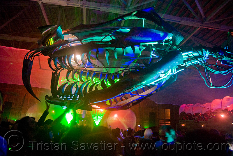 giant snake skeleton animated sculpture - opulent temple massive rave party (treasure island, san francisco) - serpent mother, art, art installation, fangs, flaming lotus girls, green laser, head, laser lightshow, laser show, lasers, night, nightclub, teeth