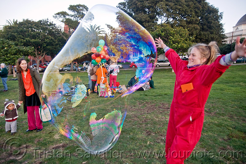 giant soap bubble, big bubble, giant bubble, iridescent, lawn, park, playing, red, soap bubbles, woman