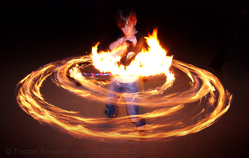 gina spinning a fire hula hoop (san francisco), fire dancer, fire dancing, fire performer, fire spinning, flames, hula hooping, long exposure, night, people, spinning fire