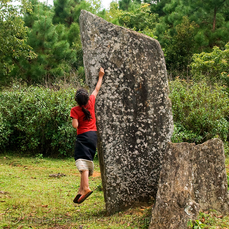 girl catching cicada on menhir (laos), archaeology, cenotaph, child, hintang archaeological park, hintang houamuang, kid, megaliths, menhirs, monoliths, people, san kong phanh, standing, standing stones
