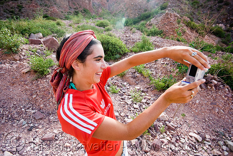 girl taking photo - pilar pitòn, adidas, argentina, digital camera, head-band, iruya, noroeste argentino, pilar, quebrada de humahuaca, red, taking photo, woman