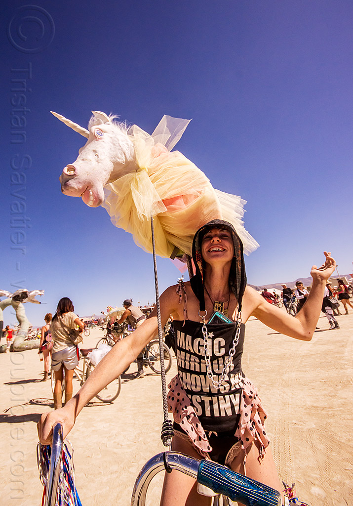 girl with unicorn - burning man 2015, bicycle, burning man, chain, headdress, hood, riding, unicorn, woman