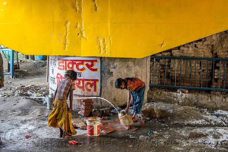 girls filling-up plastic jerrycan at water hose, bridge pillar, bucket, children, daraganj, hindu pilgrimage, hinduism, india, jerrycan, kids, little girl, maha kumbh mela, plastic pipe, plastic piping, water hose, water pipe