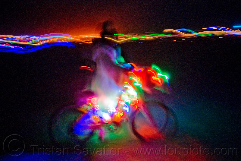glowing bicycle - burning man 2009, bike, blur, blurry, night