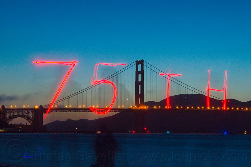 golden gate bridge 75th anniversary, bridge pillar, bridge tower, light drawing, light graffiti, light painting, long exposure, night, suspension bridge
