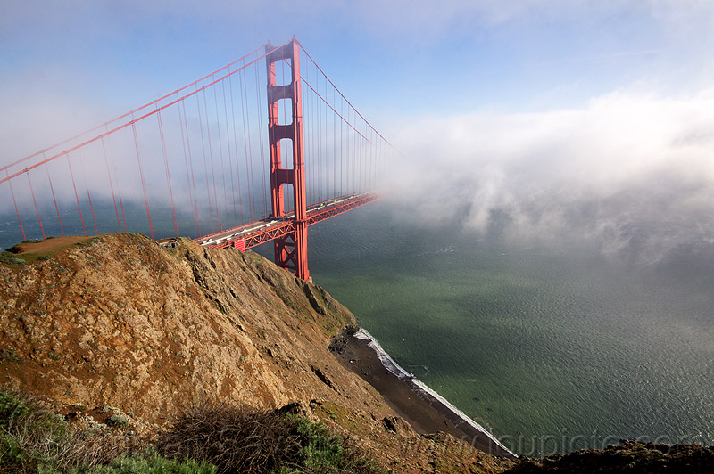 golden gate bridge in the fog - view from the spencer battery (san francisco), beach, bridge tower, cliff, fog, golden gate bridge, seashore, suspension bridge