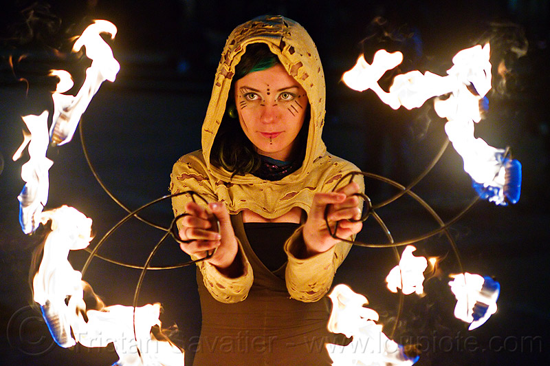 grace spinning fire fans, fire dancer, fire dancing, fire performer, fire spinning, flames, grace hoops, hood, hoodie, hoody, night, people, woman