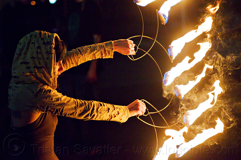 grace spinning fire fans, fire dancer, fire dancing, fire fans, fire performer, fire spinning, flames, grace hoops, hood, hoodie, hoody, night, smoke, woman
