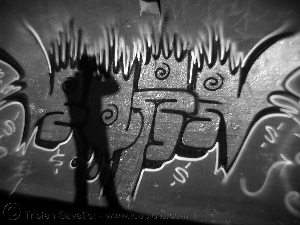 graffiti and my shadow on ocean wall - daylight infrared photo (san francisco), autognomon, daylight infrared, graffiti, near infrared, ocean beach, shadow, wall