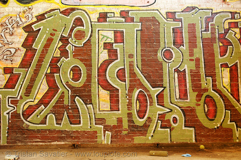 graffiti on brick wall, abandoned, abandoned factory, derelict, graffiti piece, industrial, street art, tags, tie's warehouse, trespassing