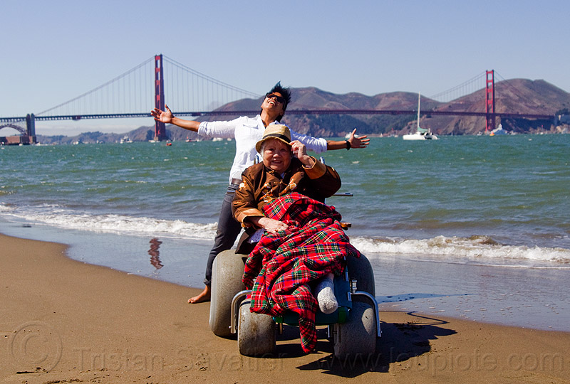 grandma and granddaughter at san francisco beach - wheelchair, beach wheelchair, blanket, chinese, crissy field beach, family, golden gate bridge, grandma, grandmother, jenn, ocean, old woman, sand, sea, senior, straw hat, suspension bridge, water, women