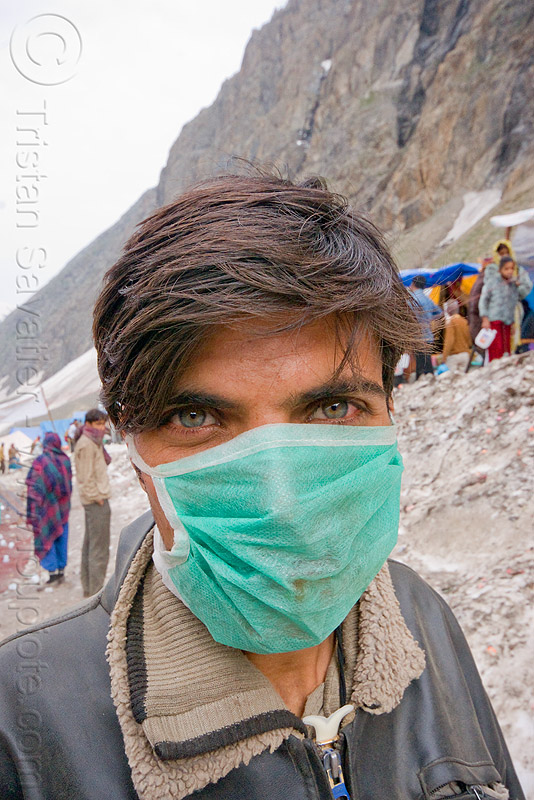 disposable dust mask, amarnath yatra, dust mask, green eyed, green eyes, kashmir, man, mountains, pilgrim, pilgrimage, snow, surgical mask, trekking, yatris, अमरनाथ गुफा