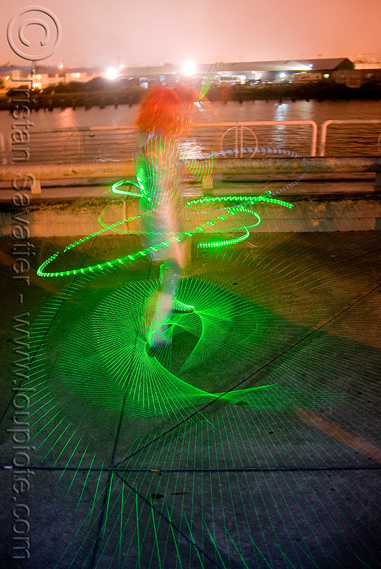 green laser hulahoop - superhero street fair (san francisco), hula hoop, islais creek promenade, laser hoop, laser hula hoop, long exposure, night, people, woman