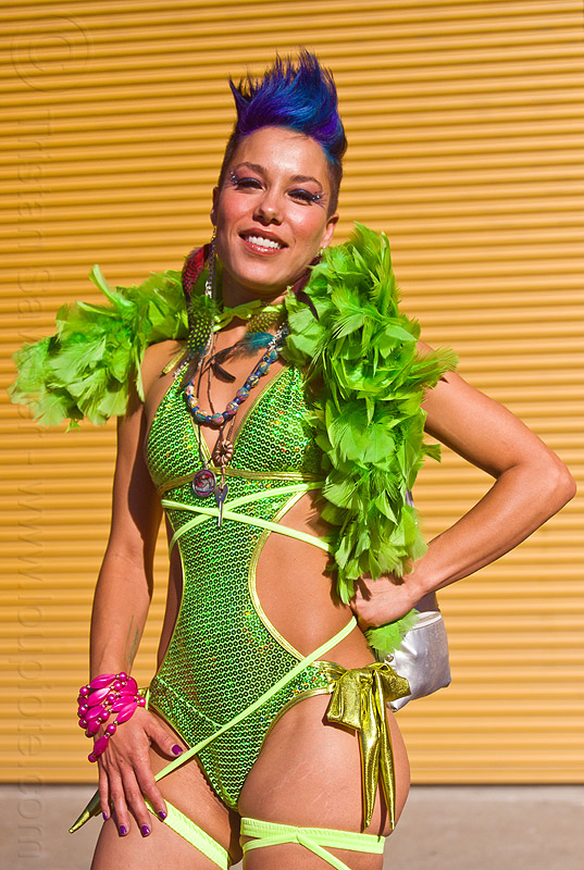green outfit with green feather boa, blue hair, burning man decompression, fashion, feather boa, feather earrings, foxy, glittery, green feathers, green outfit, identical twin, marisette, necklaces, pink bracelet, woman