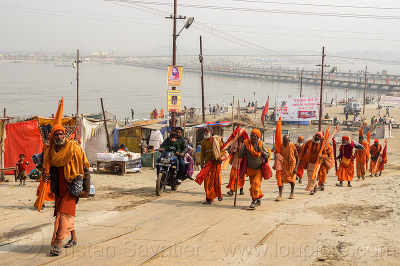 group of hindu pilgrims walking - kumbh mela 2013 (india), babas, bhagwa, floating bridge, foot bridge, ganga, ganges river, group, hindu pilgrimage, hinduism, india, maha kumbh mela, men, pilgrims, pontoon bridge, river bank, sadhu, saffron color, walking
