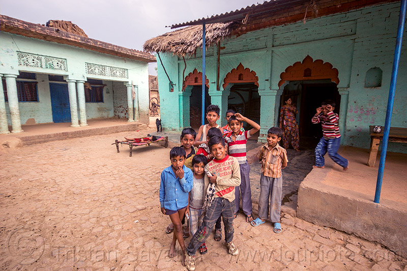 group of indian boys on village plaza, blue house, boys, children, crowd, india, khoaja phool, kids, village, खोअजा फूल