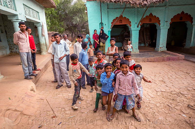 group of indian boys on village plaza, blue house, children, crowd, khoaja phool, kids, village, खोअजा फूल