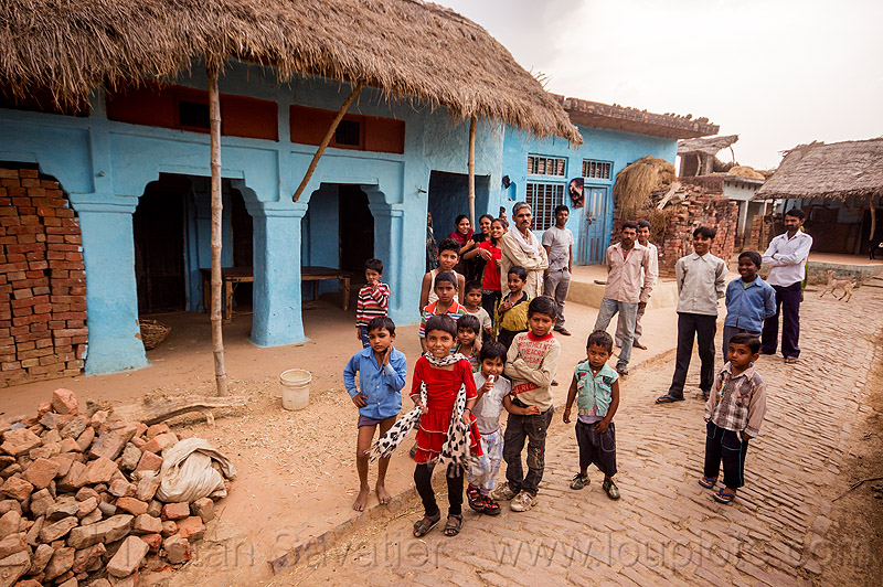 group of kids and men in indian village, blicks, blue house, children, crowd, khoaja phool, kids, men, street, village, खोअजा फूल