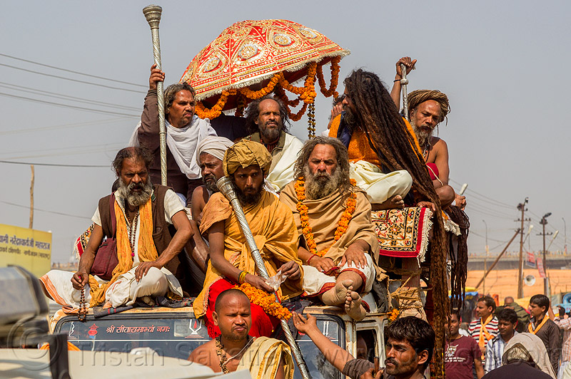 guru and his devotees on top of jeep - kumbh mela (india), beard, car, float, gurus, hindu pilgrimage, hinduism, india, jeep, kumbh maha snan, maha kumbh mela, mauni amavasya, men, parade, umbrella