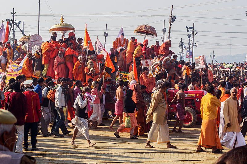 guru float pulled by tractor arrives at the sangam - kumbh mela (india), bhagwa, crowd, float, gurus, hindu pilgrimage, hinduism, india, kumbh maha snan, maha kumbh mela, mauni amavasya, parade, saffron color, umbrellas, walking