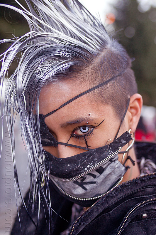 guy in punk fashion - white contact lens - zippered face mask (san francisco), color contact lenses, darik, dereck, derrick demolition, ear piercing, eye liner, eye patch, eyebrow piercing, fashion, make-up, man, mohawk hair, mouth mask, punk, special effects contact lenses, theatrical contact lenses, white contact lenses, white contacts, white mohawk, zippers