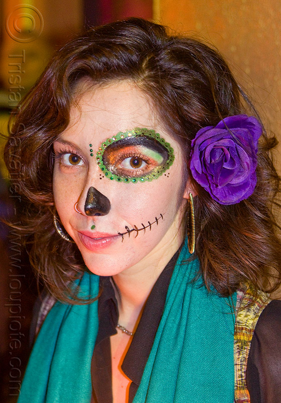 half-face sugar skull makeup, bindis, day of the dead, dia de los muertos, earrings, face painting, facepaint, half face, half face makeup, halloween, night, nose ring, people, purple flower headdress, woman