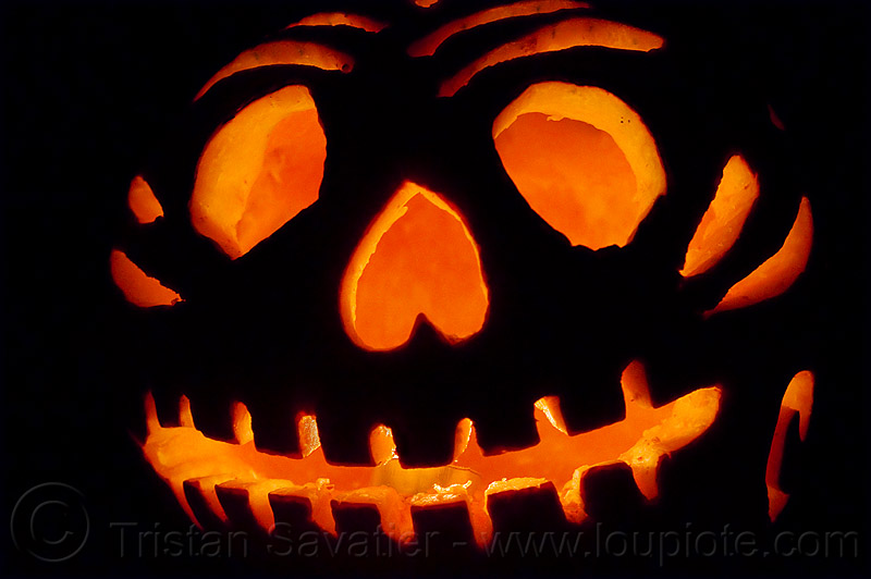 halloween carved pumpkin lit up with candle, backlight, candle light, carved pumpkin, carving, glowing, halloween, orange color, teeth
