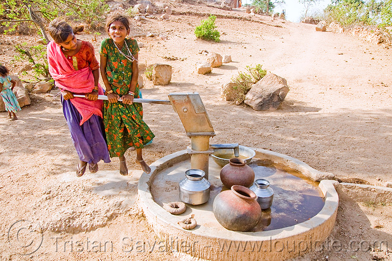 hand pump - country girls pumping water, children, clay pots, girls, hand pump, kids, little girl, two, udaipur, water jars, water jugs, water pump