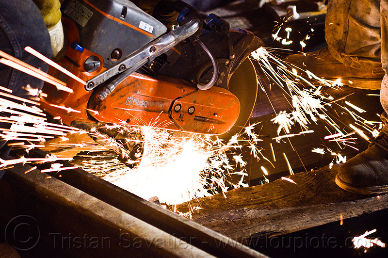 handheld abrasive saw, construction, cut-off saw, cutting, huskvama, k760, light rail, man, muni, night, ntk, people, power tool, railroad, railroad construction, railroad tracks, rails, railway, railway tracks, san francisco municipal railway, sparks, track maintenance, track work, worker, working