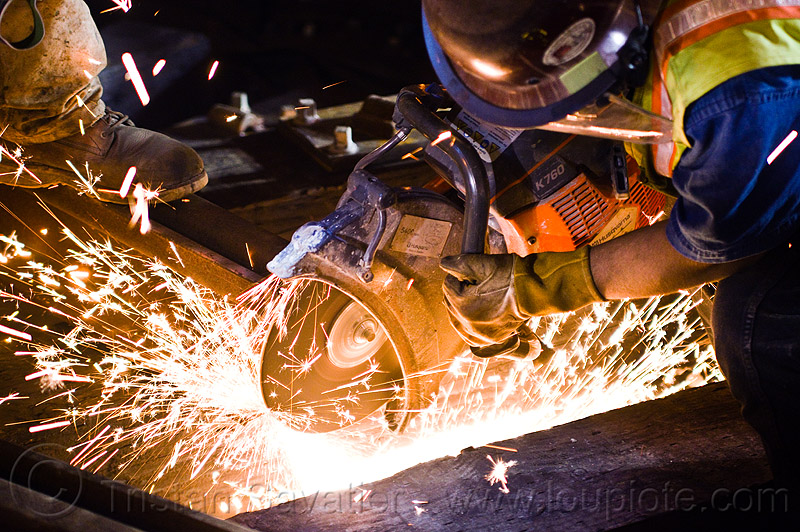 handheld cut-off saw, abrasive saw, cut-off saw, cutting, high-visibility jacket, high-visibility vest, huskvama, k760, light rail, man, muni, night, ntk, power tool, railroad construction, railroad tracks, rails, railway tracks, reflective jacket, reflective vest, safety helmet, safety vest, san francisco municipal railway, sparks, track maintenance, track work, worker, working