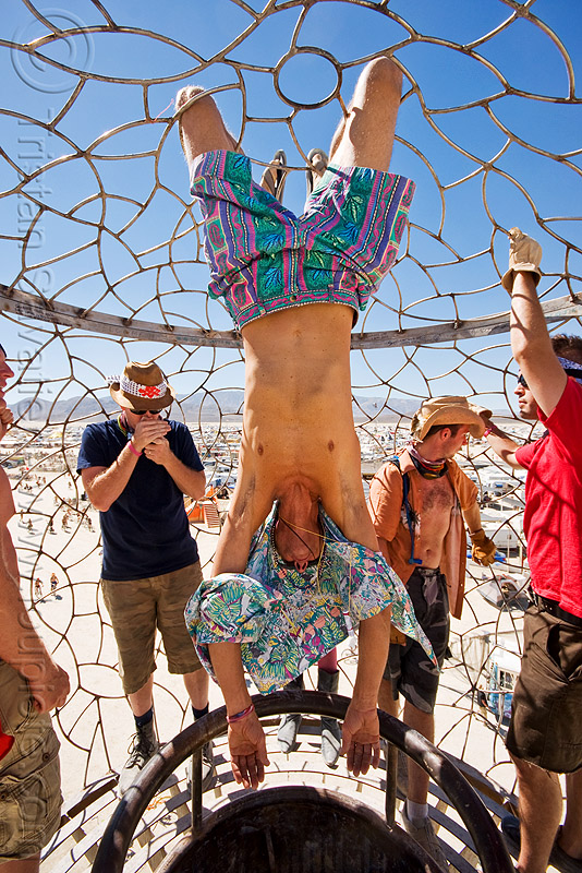 hanging in the cage at the top of the tower - burning man 2010, bryan tedrick, burning man, cage, hanging, men, ronald, the minaret, tower, upside-down