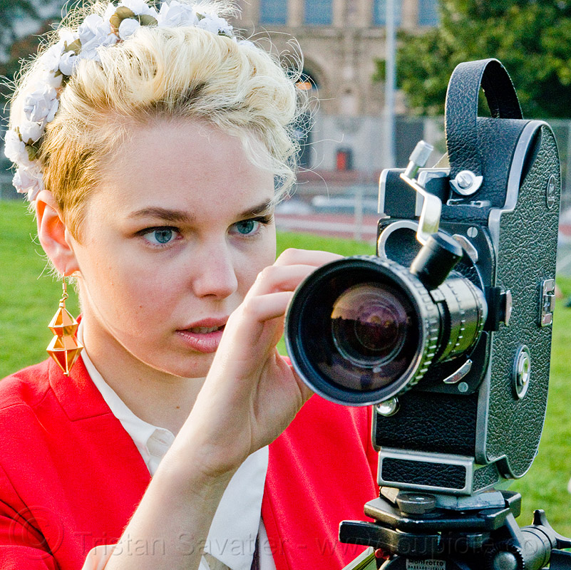 hanna mace adjusting her bolex 16mm movie camera, 16mm camera, blonde, bolex, camera operator, dolores park, film camera, film making, hannah, motion picture camera, movie camera, woman