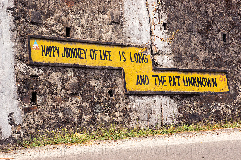 happy journey of life is long and the path unknown - BRO road sign (india), bad spelling, border roads organisation, bro, misspelled, road sign, sikkim, spelling mistake, swastik project, traffic sign, wall