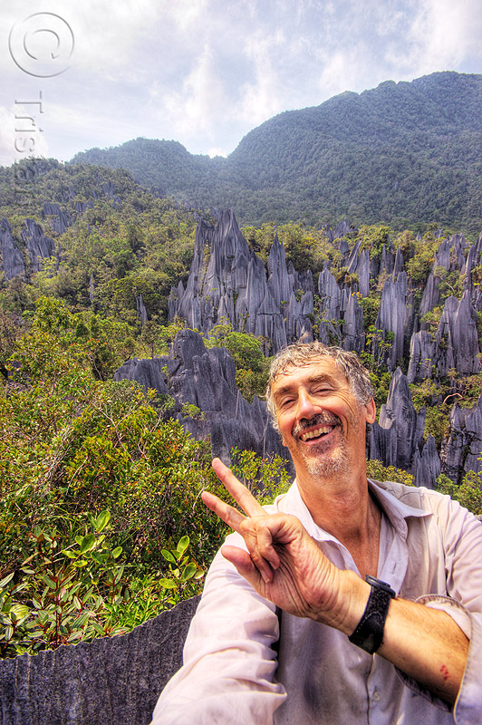 happy to have reached the mulu pinnacles (borneo), erosion, geology, gunung mulu, gunung mulu national park, jungle, karst, karstic, limestone, man, peace sign, people, rain forest, rock, self-portrait, selfie, stone, tristan savatier, v-sign