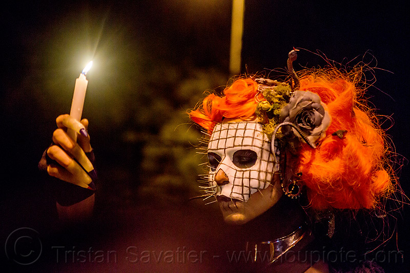 hellraiser mask - holding candle - dia de los muertos (san francisco), candle, day of the dead, dia de los muertos, face painting, facepaint, flower headdress, halloween, hellraiser, man, mask, metal necklace, nails, night, orange wig, pins, skull makeup