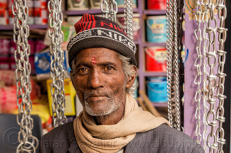 chain merchant in his chains store (india), almora, hardware, knitcap, man, market, metal, people, scarf, shop, tilak, tilaka