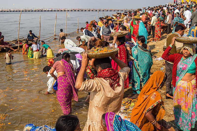 hindu devotees bring clay shiva linga's offerings to the ganges river (india), carrying on the head, clay, crowd, ganga, ganges river, hindu ceremony, hindu pilgrimage, hinduism, india, lingams, maha kumbh mela, offerings, river bank, shiva lingam, trays, walking