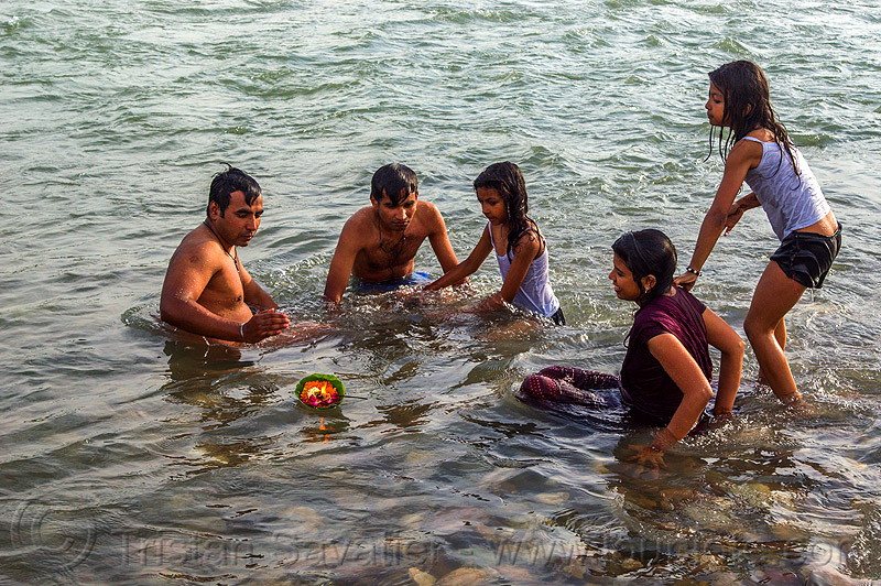 hindu family bathing in ganges river (india), burning, children, flame, floating, ganga river, ganges river, ghats, girl, hinduism, holy bath, holy dip, kids, little girls, men, offering, rishikesh, river bathing, triveni ghat, wading, water, women