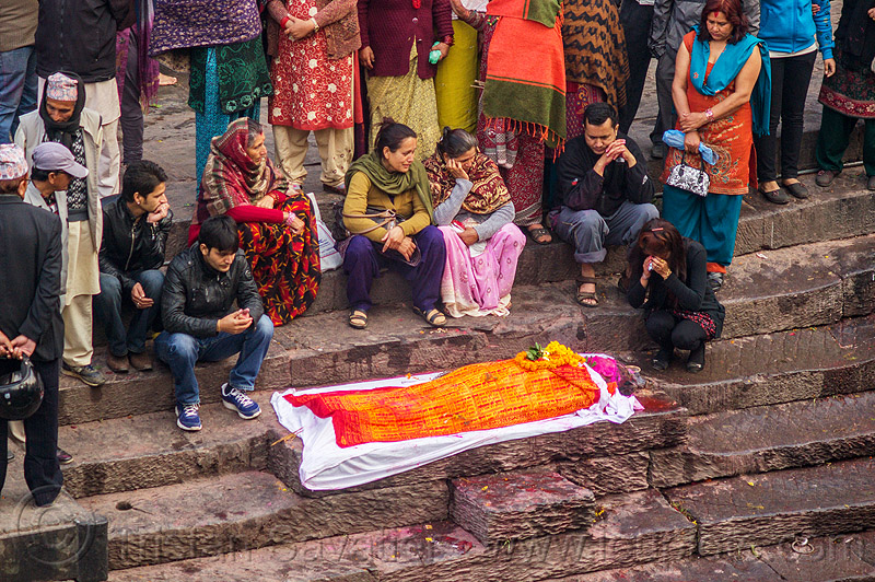 hindu funeral, corpse of the dead washed before cremation, nepal