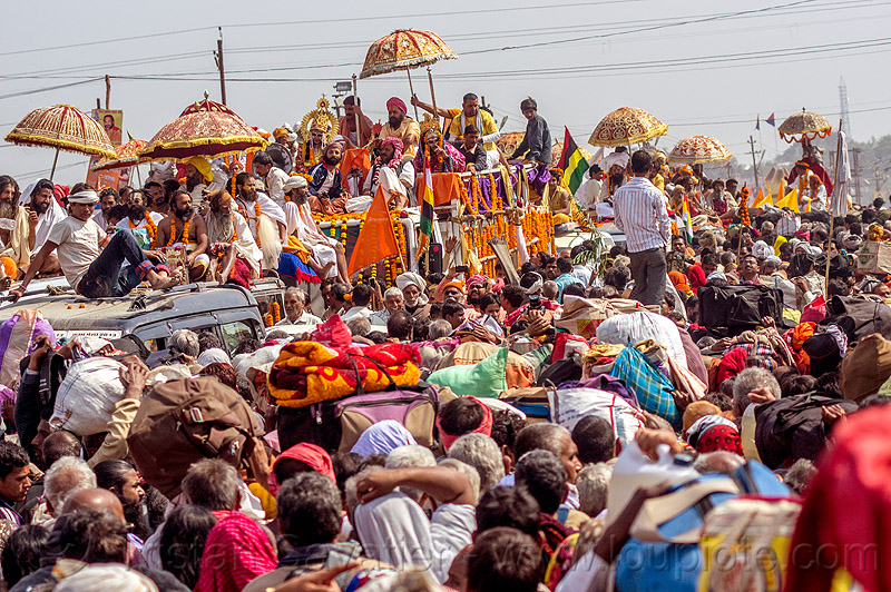 hindu guru float parade in massive traffic jam in crowded street - kumbh mela (india), crowd, float, gurus, hindu pilgrimage, hinduism, kumbh maha snan, maha kumbh mela, mauni amavasya, parade, umbrellas