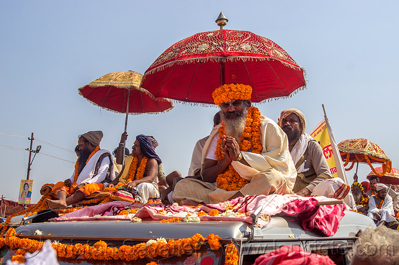 hindu guru on the roof of his decorated jeep - kumbh mela (india), amavasya, float, gurus, hinduism, kumbh maha snan, kumbha mela, maha kumbh, maha kumbh mela, mauni amavasya, men, parade, people, procession, umbrellas