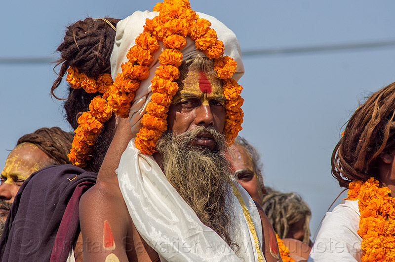 hindu guru with orange flowers headdress - kumbh mela (india), amavasya, float, gurus, hinduism, kumbh maha snan, kumbha mela, maha kumbh, maha kumbh mela, man, mauni amavasya, parade, people, procession